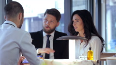 Business colleagues on a lunch Stock Footage