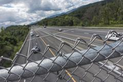 interstate highway with fence - stock photo