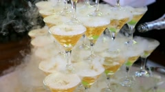 Many glasses with cocktails and liquid nitrogen smoke Stock Footage
