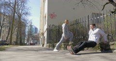 They doing morning exercises in city street Stock Footage