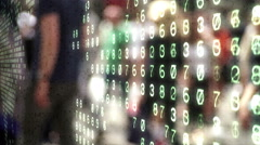 People overlaid by binary code and numbers. Stock Footage