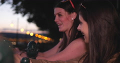Young female friends chatting on the quay - stock footage