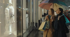 Female Friends in Front of Shop's Show Window Stock Footage