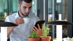 Young man in cafe with a tablet Stock Footage