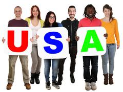 Group of young multi ethnic people holding word USA Stock Photos
