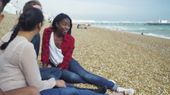 4k Portrait of attractive young woman hanging out with friends at the beach - stock footage