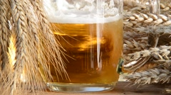 Pouring beer into the glass, detail of beer glass with wheat and barley Stock Footage