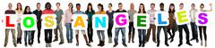 Group of young multi ethnic people holding word Los Angeles - stock photo