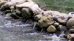 Water fall flowing though rocks in a river Stock Footage