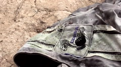 Ford Cobra jacket close up in the desert beat up Stock Footage