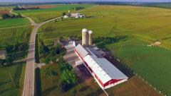 Stock Video Footage of Scenic Rural Midwest Flyover, Landscape With Farms and Silos