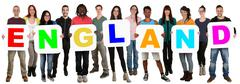 Group of young multi ethnic people holding word England - stock photo