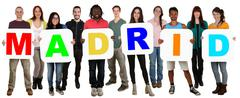 Group of young multi ethnic people holding word Madrid Stock Photos