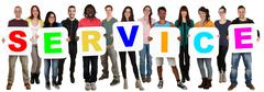 Group of young multi ethnic people holding word service Stock Photos