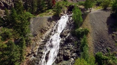 Camera follows a waterfall down from top to bottom. Stock Footage