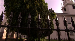 Iron fence and church cemetery Stock Footage