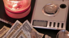 Drug Dealing Tools, Scale, Cash, and Syringe, Close Up Stock Footage