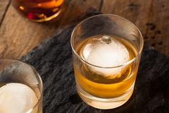 Bourbon Whiskey with a Sphere Ice Cube Stock Photos