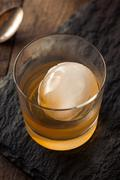 Bourbon Whiskey with a Sphere Ice Cube - stock photo