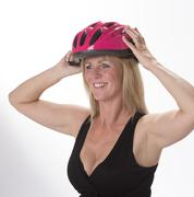 Female cyclist wearing a cycle helmet Stock Photos