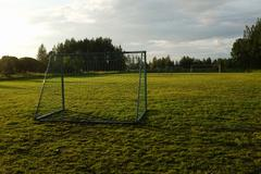 Soccer goal on the rural sports field Stock Photos