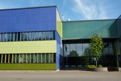Modern building with blue and green color wall Stock Photos