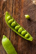 Organic Green Sugar Snap Peas - stock photo