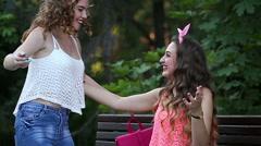 Cheerful girlfriends meet in a park. Best friends. BFF Stock Footage