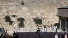 Rabbi blow the Shofar when 65 Bible  scrolls inaugurated in Western Wall Stock Footage