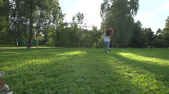 Young girl in Park with a very cute puppy Jack Russell Terrier running around Stock Footage
