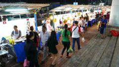Local Thai people walk aside stalls, night street food market against mall Stock Footage