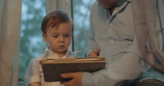 Father and little son using tablet computer at home Stock Footage