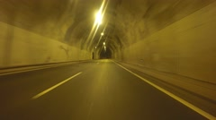 P.O.V. Driving in a tunnel - stock footage