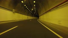 Driver view of driving in a tunnel Stock Footage
