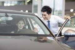 Young woman taking a test drive - stock photo