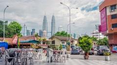Street Cafe Vew on Petronas Towers Kuala Lumpur Malaysia Time Lapse Stock Footage