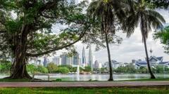 Park View of Petronas Towers Kuala Lumpur Time Lapse Malaysia daylight Stock Footage