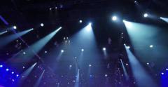Colorful beams blue light light show dark industrial interior 4K UHD Timelapse Stock Footage