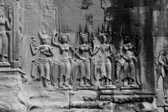 Apsara dancers decorate Angkor Wat - stock photo