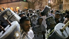 Revelers dance with 65 Bible Torah scrolls inaugurated in Western Wall - stock footage