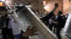 Young Rabbi dances with Bible Torah scrolls inaugurated in Western Stock Footage