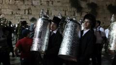 Young Rabbi dance with Bible Torah scrolls inaugurated in Western Wall Stock Footage