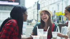 4k Happy female friends chatting at outdoor cafe in the city. Stock Footage