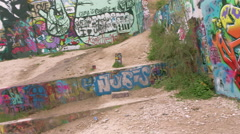 Graffiti walls to CU of one brightly colored wall in Austin, TX Stock Footage