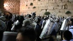 Revelers dance with 65 Bible Torah scrolls inaugurated in Western Wall Stock Footage