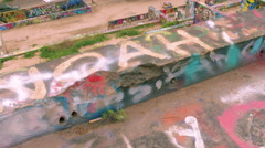 Graffiti wall to Austin City Skyline, tilt up from wall, WS - stock footage