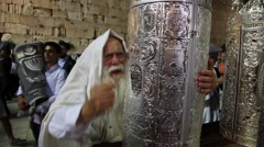 A very old rabbi dances with Bible Torah scroll inaugurated in Western Wall - stock footage