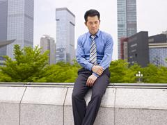 Frustrated asian business executive Stock Photos