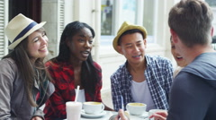 4k Happy mixed ethnicity group of friends pose for photo at outdoor cafe - stock footage