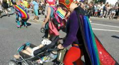 Super hero costume parent with buggy at Gay pride parade in Stockholm Stock Footage